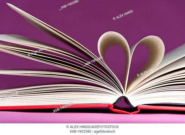 Book pages folded together into a heart shape