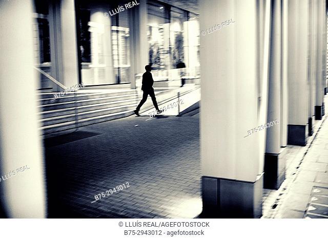 Silhouette of man walking. London. england