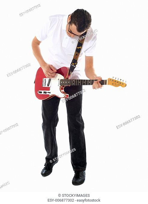 Handsome casual man with guitar looking down. Isolated on white background