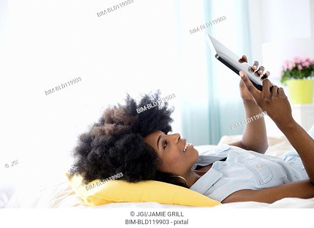 Mixed race woman using digital tablet