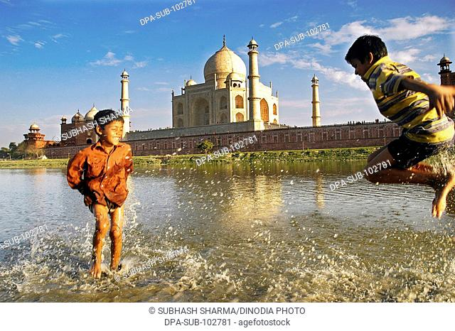 Children playing water river Yamuna flowing Taj Mahal Agra Ancient artist artistic beautiful blue sky boys children kids clouds Color constructed 1631 A