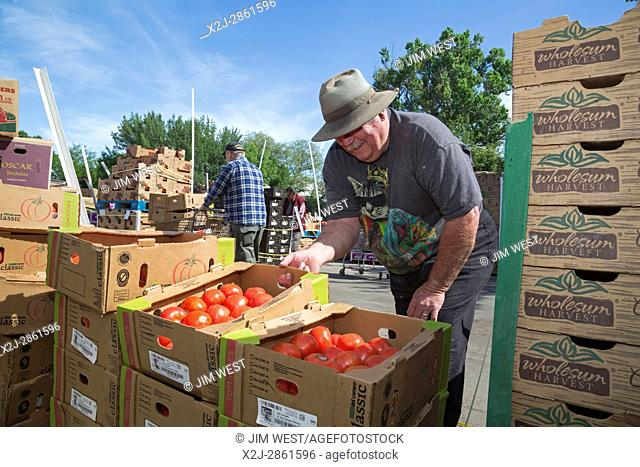 Nogales, Arizona - Representatives of nonprofit organizations from southern Arizona and Sonora, Mexico pick up food for their organizations at the Borderlands...