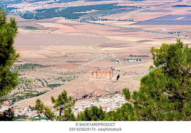 Well preserved castle with four round towers above La Calahorra, Andalucia, Spain