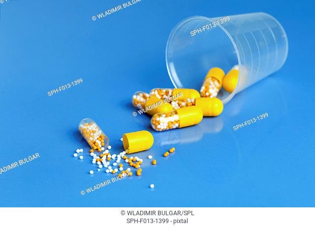 Yellow capsules against a blue background