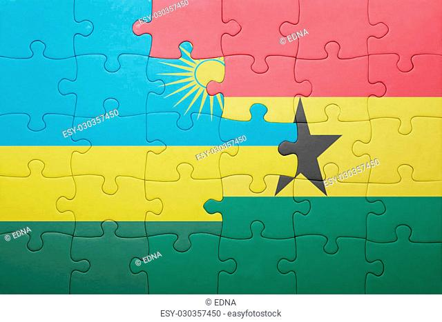 puzzle with the national flag of ghana and rwanda . concept