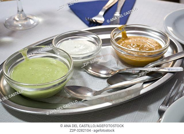 Three of the most popular Canary Islands popular sauses Mojo picon (Red hot sauce) Garlic mayonnaise and Mojo verde (Green sauce) are usually eaten with Papas...