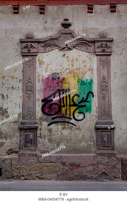 Graffiti on historical exterior wall