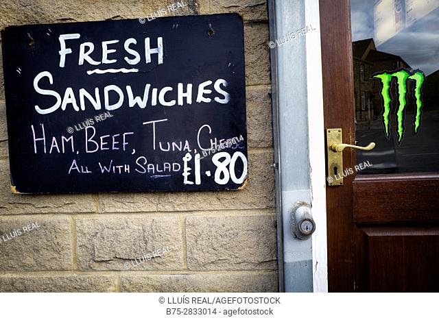 "Blackboard on the front of a cafe reading ""Fresh Sandwiches, Ham, Beef, Tuna, Chees, All with Salad 1.80"", Keighley, Bradford, West Yorkshire, UK"