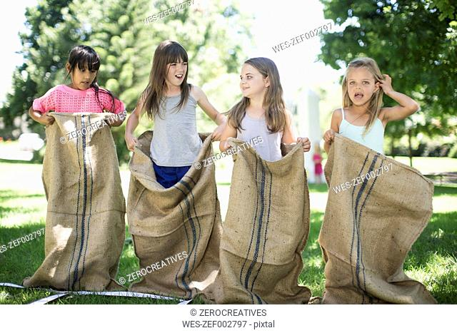 Girls competing in a sack race