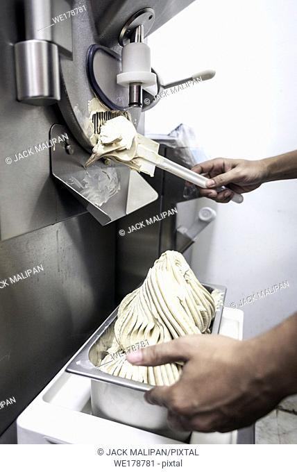 making gelato ice cream with modern professional equipment preparation detail in kitchen interior