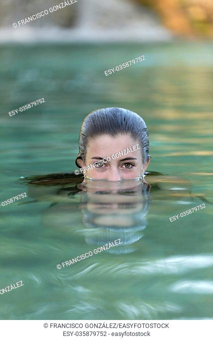 Teenager bathing in a lake. Place of the taking Castilla la Mancha, Spain