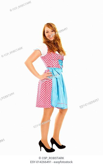 standing young redhead woman in bavarian dress on white background