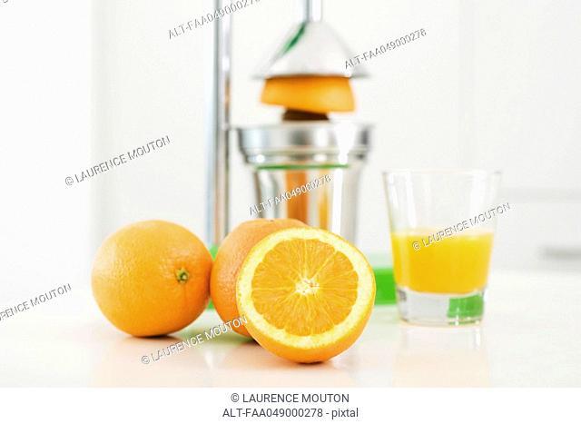 Making fresh-squeezed orange juice