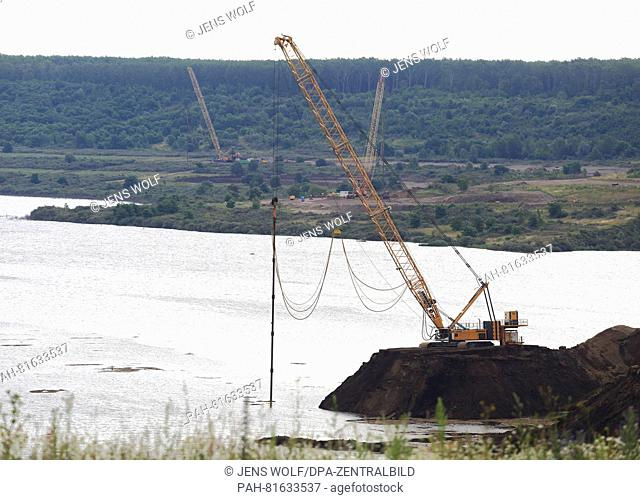 A crane seen at a break-off edge at Lake Concordia in Nachterstedt, Germany, 29 June 2016. Another landslide occurred at the former mine