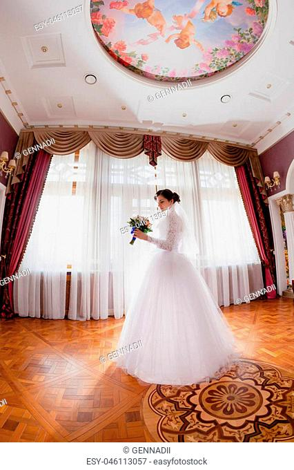 Bride portrait indoor rich royal room with classic design