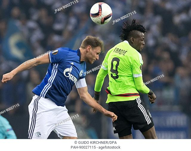 Schalke's Benedikt Hoewedes (l) and Ajax's Bertrand Traore vie for the ball during the second leg of the UEFA Europa League quarter final tie between FC Schalke...
