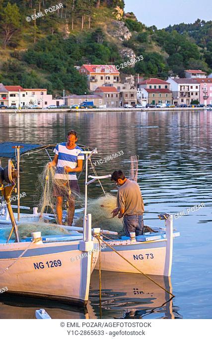 Fishermen on boats Novigrad small coastal town in Croatia