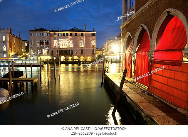 Canal Grande or Gran Canal by night on January 22, 2016 in Venice, Italy. Rialto fishing market