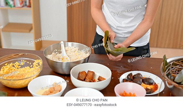 Woman wrap rice dumpling at home