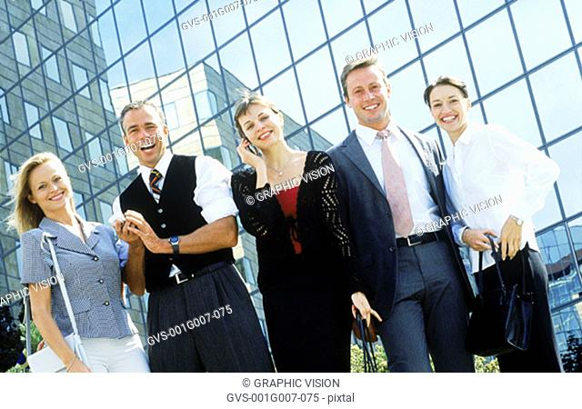 Portrait of young business executives standing together
