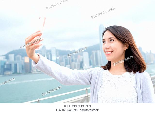 Woman take selfie at outdoor