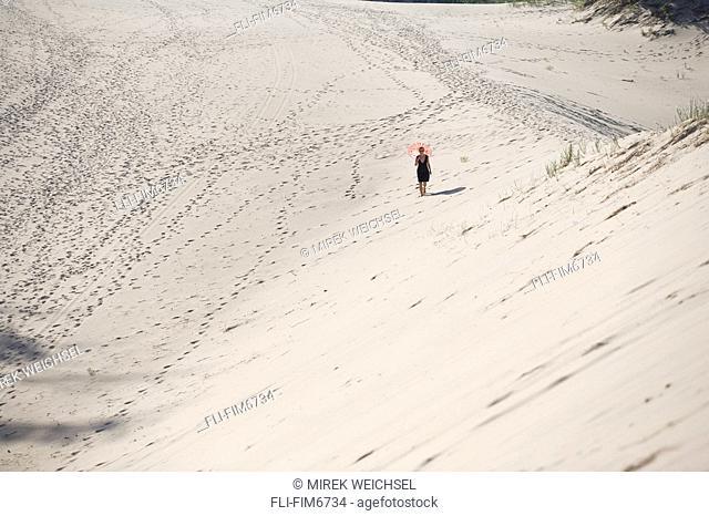 Woman walking on the dunes, Warren Dunes State Park, Michigan