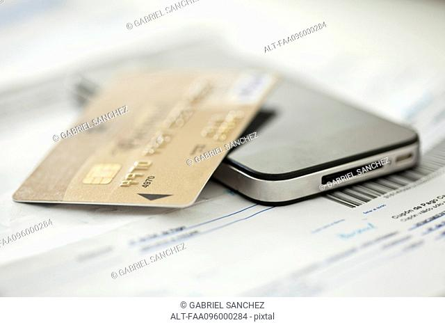 Credit card resting on smartphone