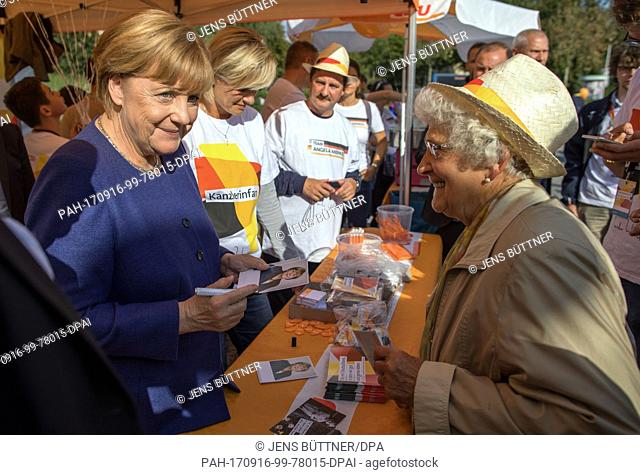 German Chancellor Merkel (CDU) gives autograhps in Stralsund, Germany, 16 September 2017. Germany's Christian Democractic Union's (CDU) head is en route in her...
