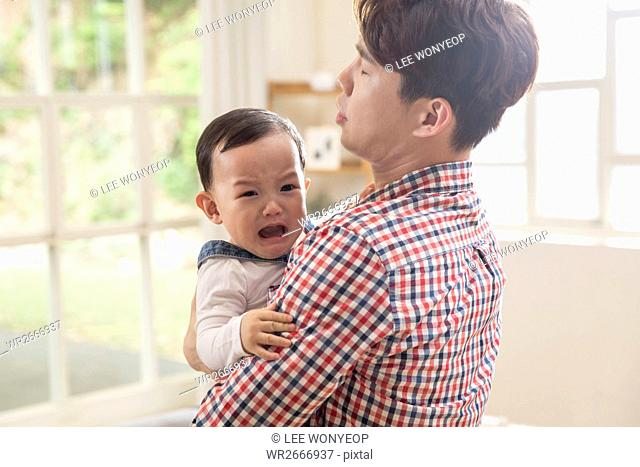 Father soothing his baby son