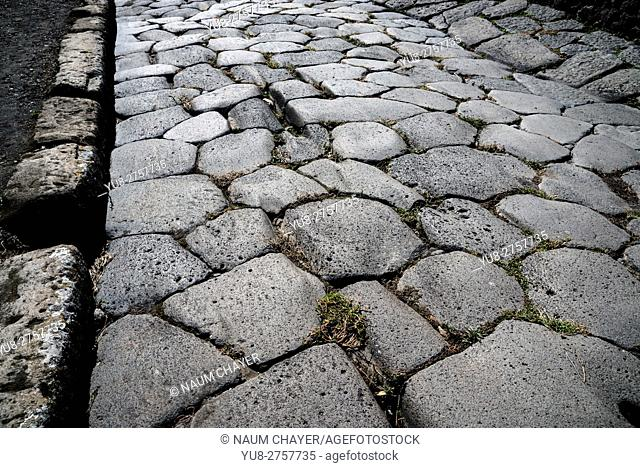 A paved street, Example of world famous antique Roman construction of roads, Pompeii, archaeological site, Campania region, Italy