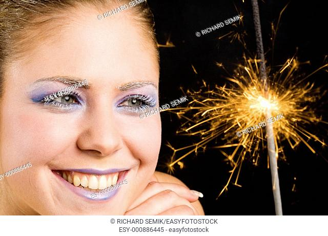 portrait of woman with fire-cracker