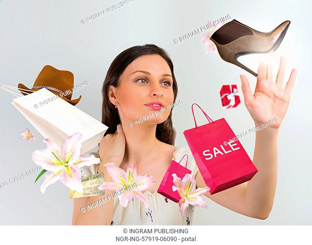 Woman shopping online using her virtual interface