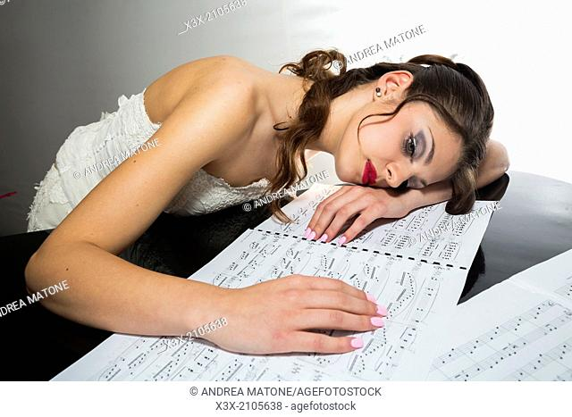 Bride portrait on music sheets