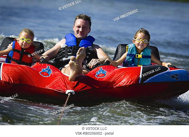 Dad with kids on inner tube