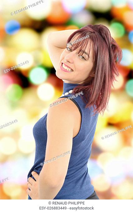 beautiful young woman with red hairs, bokeh background