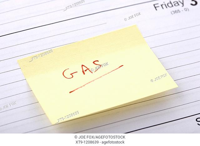 post-it note regarding gas bill stuck into a diary at the end of the month