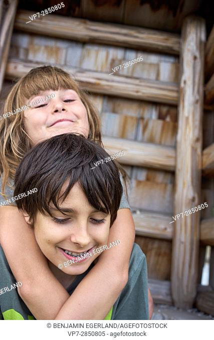 Two young children enjoying their friendship while embracing each other