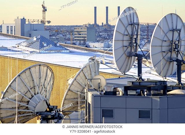Satellite dishes over Potsdamer Platz with the Staatsbibliothek in the background in Berlin, Germany