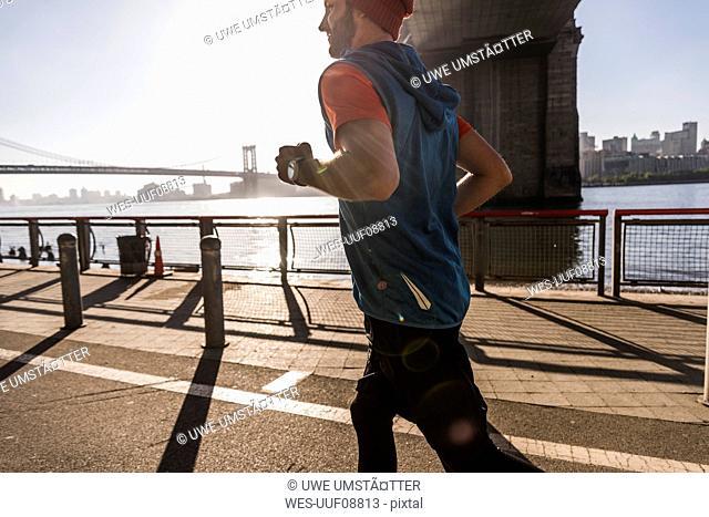 USA, New York City, man running at East River