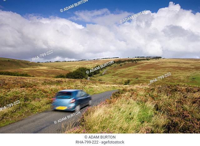 Tourists driving through the moorland of Exmoor National Park, Somerset, England, United Kingdom, Europe