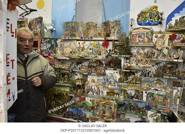 Czech collector Libor Pistelka poses with his collection of 1540 nativity scenes at the Museum Gallery in Svabenice, Czech Republic, on December 21, 2017