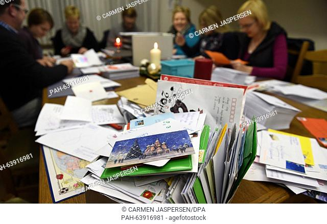 Employees of 'Santa Claus' respond to letters in the Santa Claus office in Nikolausdorf (lit. Nicholas village), Germany, 24 November 2015