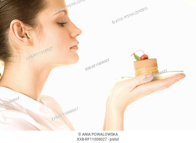 Young woman with cake