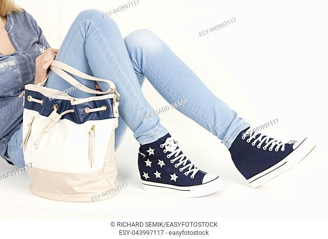 detail blue boot and handbag