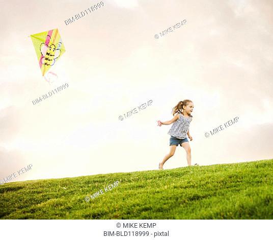 Caucasian girl flying kite