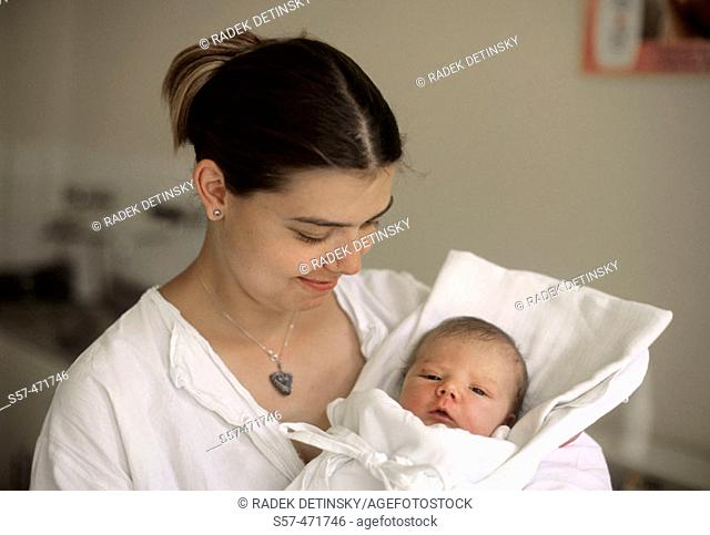 portrait of a new born baby-girl (two days old) with her mother