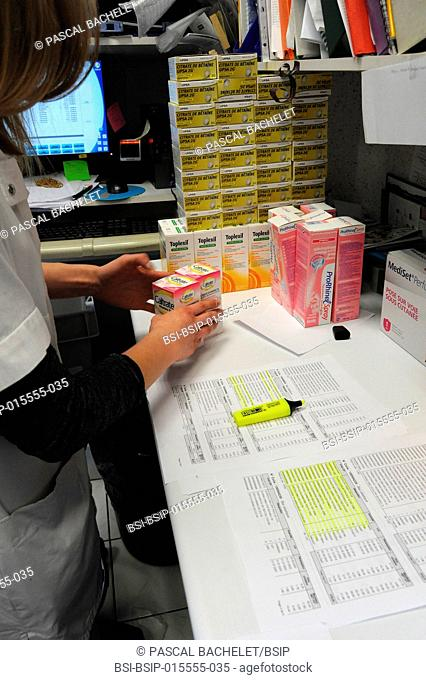 Reportage in a pharmacy in Auxi-le-Château, France. Receiving an order