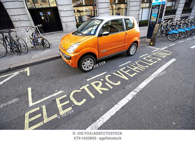 electric vehicles parking bay and car charging point london england uk united kingdom