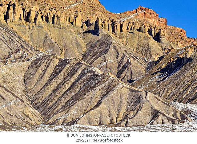 Melting snow on eroded butte, near Grand Junction, Colorado, USA