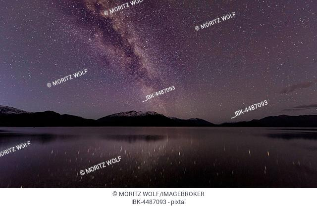 Night Scene, Wanaka lake with stars and Milky Way, stars mirroring in the water, Glendhu Bay, Otago, Southland, New Zealand